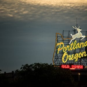 Night glowing stag sign old town Portland Oregon