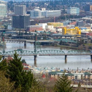 Hawthorne Bridge by waterfront condominiums over Willamette River in downtown Portland Oregon United States America