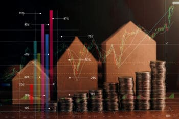 business financial saving and insurance ideas concept with house model and money coin stack dark image tone