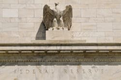 close up of the eagle statue on the Federal Reserve building in Washington DC