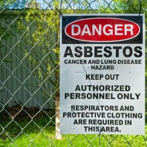 Asbestos sign warning people of the dangers ahead.